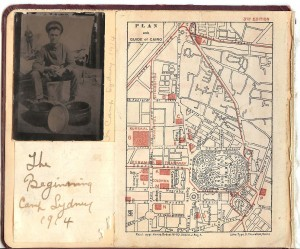 The inside cover of the missing First World War photo album.  A note which is pasted to the cover obscures handwriting which appears to be the service number 889 and the first portion of John's name.