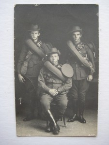 A rare Great War photograph of three diggers of the Australian Field Artillery AIF taken in Australia prior to overseas deployment. Of particular interest is the fact they are displaying both issue of headwear ... the famous Australian Slouch Hat and the Peaked Cap issued to drivers, artillerymen and other corps including Infantry.